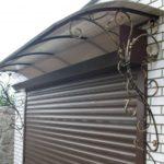 Как сделать козырек над гаражом своими руками