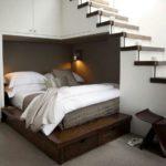 Спальная кровать под лестницей фото