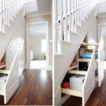 Выдвигающийся шкаф под лестницей фото